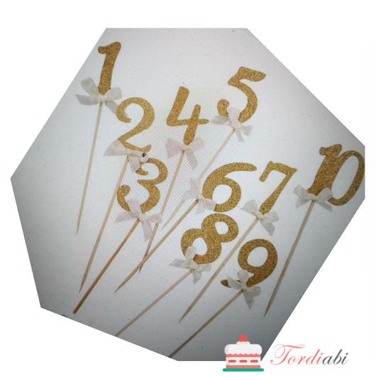 Tordiabi kuldsed numbrid topperid