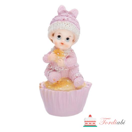 Tordiabi tüdruk muffinil