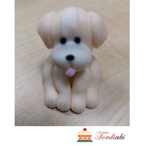 Tordiabi suhkrust hele istuv koer